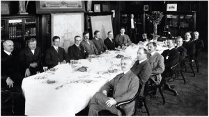 Lunch meeting of key planners in D. H. Burnham and Company offices, with illustrations from the Plan of Chicago on walls (1908). Chicago History Museum, ICHi-03560